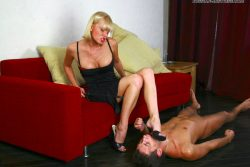 Slave cleaning feet and heels of his Russian mistress