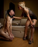 Gorgeous blonde mistress from Russia spits on her slave and dominates him