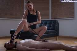 Gorgeous domina enjoys her foot worship session