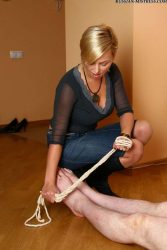 Beautiful blonde Russian mom enjoys her feet licking session with her slave