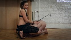 Cruel and young mistress plays with her male toy