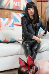 Licking leather boots and feet of beautiful dark haired Russian mistress