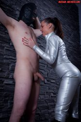 Latex Russian mistress gives him harsh handjob that he cant resist