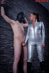 Latex Russian mistress gives him harsh handjob that he cant resist