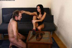 Merciless brunette from Russia treats her slave brutal way