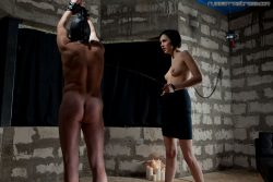 Beautiful dark haired mistress playing with her slave