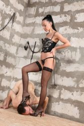 Beautiful lady lets her slave worship her feet
