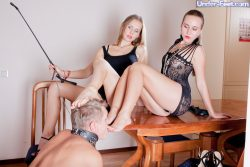 Two gorgeous russian mistresses have some femdom fun with their slave