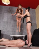 Two mistresses trampling their slave