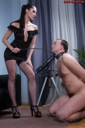 Rough young dominatrix makes her slave eat her pussy and drink piss