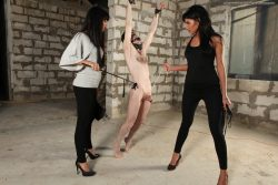 Two brutal and beautiful mistresses squeeze his balls and kick him