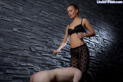 Slave cant resist the seductiveness of his dominas shapely legs and feet