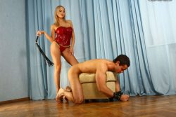 Beautiful blonde Russian Mistress forces her slave to lick her pussy and feet