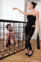 Slave is let out of his cage to get his mouth gagged with his dommes feet