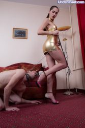 Spanking her slave with whip
