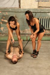 Two beautiful dominatrixes and golden shower games