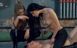 Two gorgeous mistresses trampling their frumpy slave, use him as an ashtray